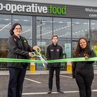 Store manager Rebecca Mott and colleagues cut the ribbon on the new £2.2m Co-op at Sutton near Ely.