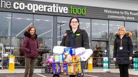 Store manager Rebecca Mott donates food and essentials to food bank partner Ely Food Bank to mark the launch of the new Sutton Co-op