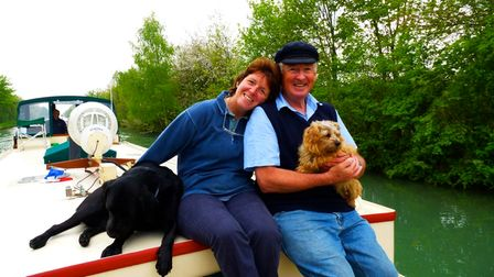 Fee Sharples, 65, from Hardingham and her husband John on a boat