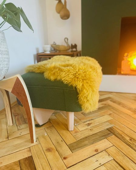 The brothers have transformed their mum's living room with the impressiveherringbone flooring using all recycled materials.