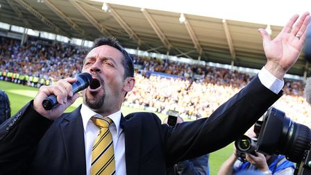 Hull City manager Phil Brown sings to the fans at the final whistle after his side avoided relegatio