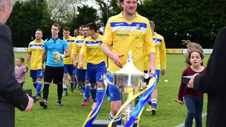 Norwich United(yellow) play Walsham Le Willows at Diss to win the Thurlow Nunn League Cup final.Pict