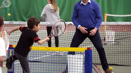 Liberal Democrat leader Nick Clegg (right) playing mini-tennis at a leisure centre in Solihull with