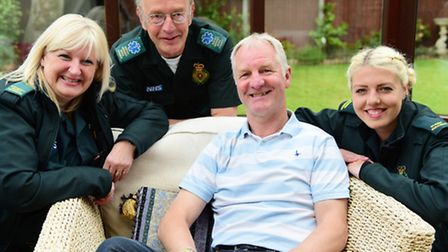 Former Norwich City footballer, Shaun Elliott, front, thanks the paramedics who helped him after he