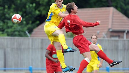 Stuart Wall, left, in action for King's Lynn Town against his new club in 2012. Picture: MATTHEW USH
