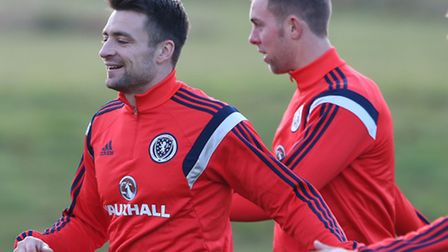 Norwich City team-mates Russell Martin (left) and Steven Whittaker will have Scotlanbd duties to kee