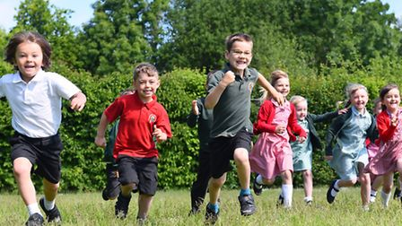 Sutton Infant School has received a Good Ofsted report. Pupils enjoying the sunshine. Picture: Jame