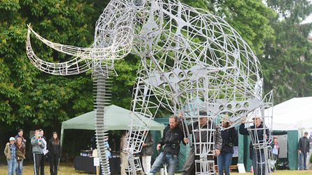 The full size replica of the West Runton mammoth takes a walk at the Welborne Arts Festival. On the