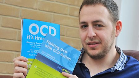 Aron Bennett, with some OCD Action literature.