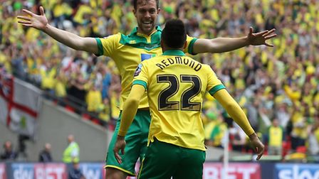 Steven Whittaker and Nathan Redmond celebrate Norwich City's second goal at Wembley - earning them t