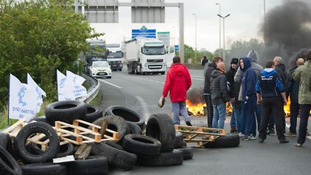 Striking ferry workers burn tyres as they block a ramp leading into the Eurotunnel. (AP Photo)