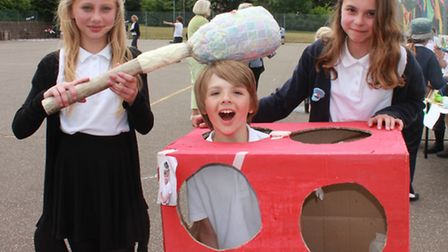 Eleven-year-olds Samantha Graves, Nathan Norfield and Willow Bushell with the Whack the Rat game the