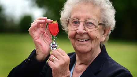 D-Day veteran Margaret Dickenson with the Legion d'honneur which she has been awarded.Picture: ANTON