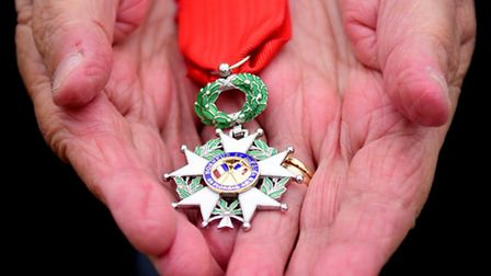 D-Day veteran Margaret Dickenson with the Legion d'honneur which she has been awarded. Picture: ANTO