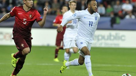 England's Nathan Redmond, right, runs with the ball as Portugal's Raphael Guerreiro, left, tries to