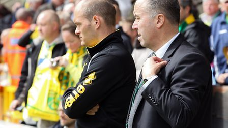 Norwich City manager Alex Neil and chief executive David McNally watch on at Carrow Road before kick