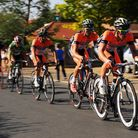 Riders on the Tour of Britain power through the Norfolk village of Mattishall in 2012. Photograph Si