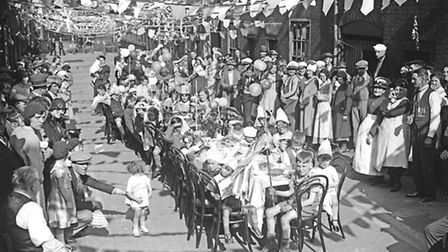 Celebrating the Silver Jubilee of George V in Rose Yard, Norwich, in May 1935.