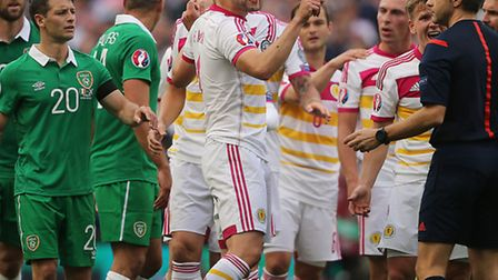 Russell Martin reacts after suffering a bloody nose whilst on duty for Scotland in Dublin.