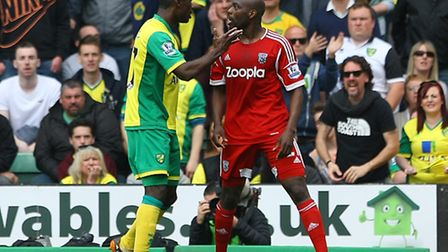 Alexander Tettey of Norwich and Youssuf Mulumbu of West Brom clash during the Barclays Premier Leagu