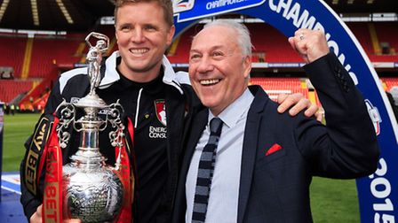 Eddie Howe, left, celebrates winning the Championship with Jeff Mostyn. Picture: PA