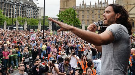 Russell Brand speaks at the End Austerity Now rally in Parliament Square, London. Photo: John Stillw