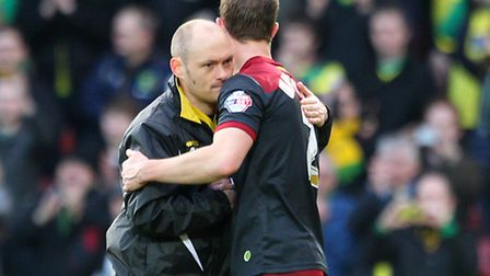 Norwich Manager Alex Neil and Steven Whittaker of Norwich celebrate victory at the end of the Sky Be