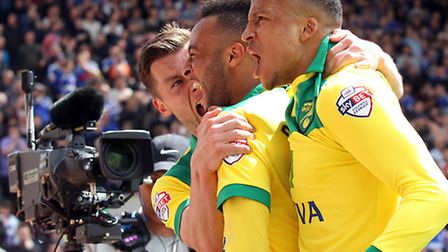 Norwich City players celebrate yet another victory over Ipswich Town in front of the TV cameras as t
