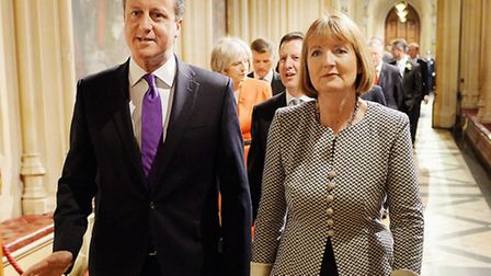Prime Minister David Cameron and acting Labour party leader Harriet Harman walk from the House of co