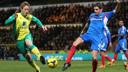 Luciano Becchio of Norwich and Alex Bruce of Hull City in action during the Barclays Premier League
