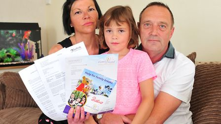 Ruby Rose who is Autistic with her step-father Stuart Parker and mother Amanda Herdsman. The family