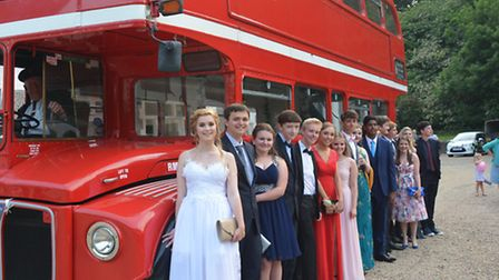 ALL ABOARD: Prom-goers alight from their party transport, an old-fashioned double-decker London bus.