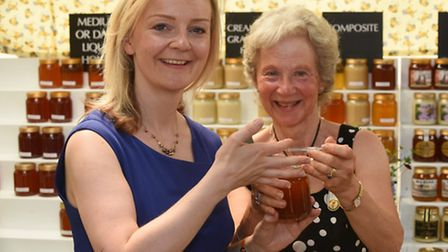 First day at the Royal Norfolk Show. Defra secretary Elizabeth Truss visits the Norfolk Beekeepers A