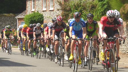 Action from the VC Norwich Road Races, not much room for manoeuvre among the men at Great Cressingha