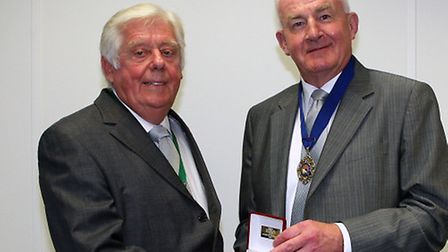 Ray Kiddell, pictured left, had a key role in the development of the women's game in his long-standi