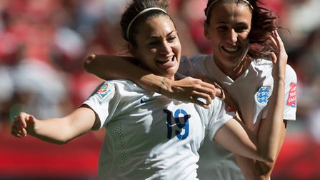 England's Jodie Taylor, left, and Jill Scott celebrate Taylor's goal against Canada. (Darryl Dyck/Th
