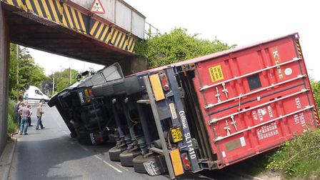 This photo of a lorry after it had hit the bridge shows the old height sign.