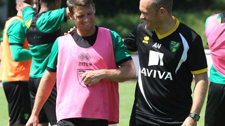 Norwich manager Alex Neil and Wes Hoolahan share a joke during a training session at the club's Germ