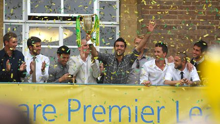 Norwich City players celebrate promotion to the Premier League on the balcony of City Hall in 2011.