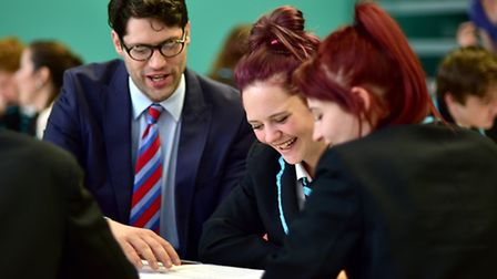 Open Academy students spend the day with business mentors. Tom Sandland, an internal accountant from