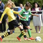 Football action from the Cromer Youth Football Club tournament at Holt FC Ground - Cromer Superstars