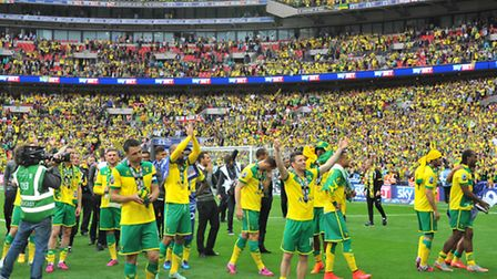 Norwich City players and fans celebrate play-off glory at Wembley. Picture: Simon Finlay