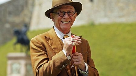 Sir John Hurt after being awarded a knighthood by Queen Elizabeth II during an Investiture ceremony