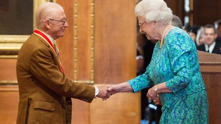 Sir John Hurt is awarded a knighthood by Queen Elizabeth II during an Investiture ceremony at Windso
