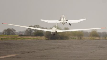 The Norfolk Gliding Club open day at Tibenham Airfield. The tug aircraft tows a glider up into the s