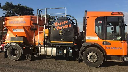 Cambridgeshire and Peterborough isset to receive 20 per cent less funding for highways maintenance from the government this year. Pictured is the 'Dragon Patcher' that is capable of tackling up to 150 potholes a day.
