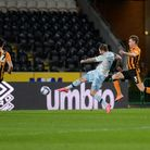 Ipswich striker James Norwood scores the opening goal at Hull City