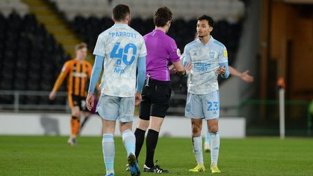 Andre Dozzell is spoken to by the referee after a first half challenge at Hull City