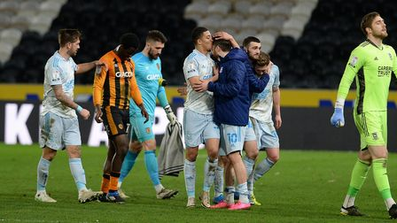 Match winner James Norwood gets a kiss on the head from team-mate Myles Kenlock at Hull City