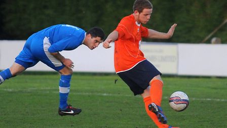 Diss Town (orange shirts) V Brantham at Brewers Green Lane in Diss. Adam Burroughs scores for Diss a